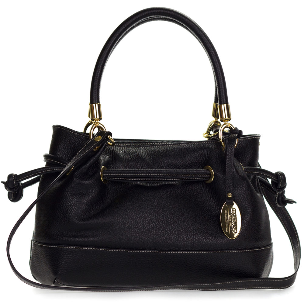 The black leather tote bag is a tried-and-true companion. Unlike the trendy mini bags, it never judges your clutter! Find your new travel buddy with this list of timeless carryalls.